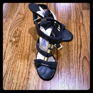 Jimmy Choo black ankle sandals with gold hardware